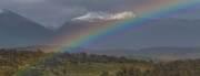 Regenbogen vor den Bergen von Feuerland